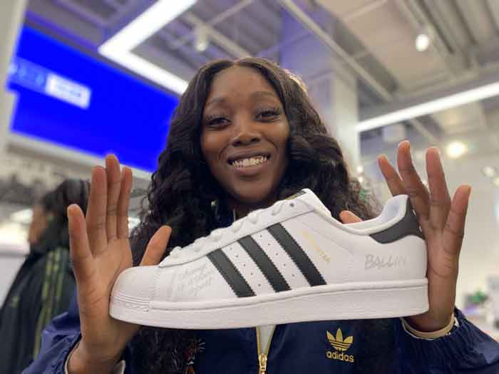WNBA Player holding custom engraving shoes | Ink Wells
